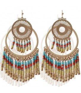Mooie goudkleurige oorbellen met blauwe kralen