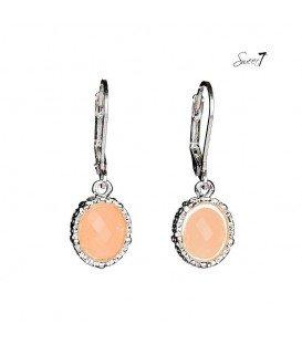 roze oorbellen met een zilverkleurige rand